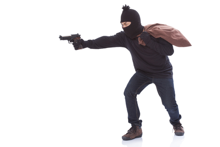 gag: Bandit holding gun with bag on white background