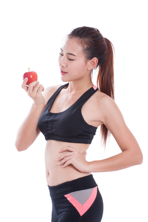 healty: Fitness woman holding apple on white background. healty concept Stock Photo