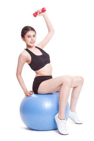 gym ball: Fitness woman sport training with exercise ball and lifting weights