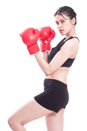 female boxing: Boxer woman. Boxing fitness woman smiling happy wearing red boxing gloves on white background.