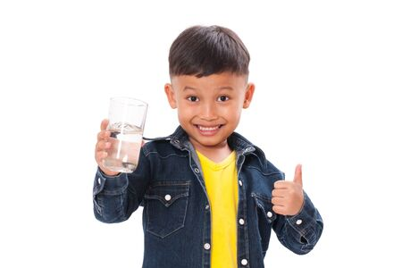 thump: Happy boy with bottle of water and showing thump up isolated on white background