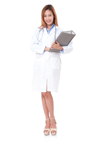 doctoring: Doctor with a stethoscope and holding a clipboard. Stock Photo