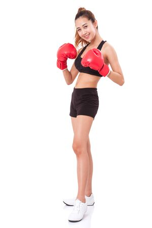 white gloves: Boxer - Full length fitness woman boxing wearing boxing red gloves on white background.