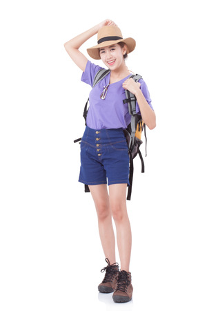 Happy woman traveler with backpack on white background Stock Photo