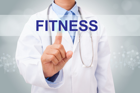 Doctor hand touching FITNESS sign on virtual screen. medical concept Stock Photo
