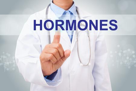 hormonas: Médico mano tocar las HORMONAS firman en la pantalla virtual. concepto médico