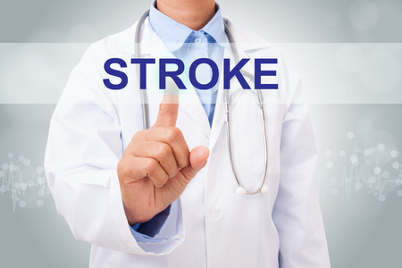 sudden death: Doctor hand touching STROKE sign on virtual screen. medical concept Stock Photo