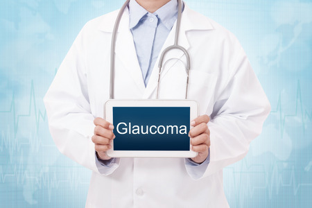 Doctor holding a tablet pc with Glaucoma sign on the display