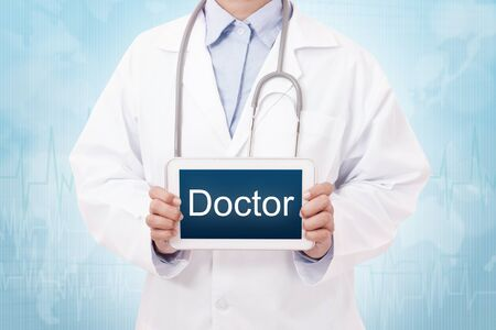 healthcare facilities: Doctor holding a tablet pc with doctor text on blue background