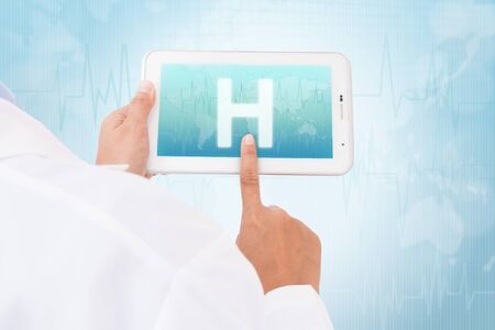 human touch: Doctor hand touch screen Hospital symbol on a tablet. medical icon