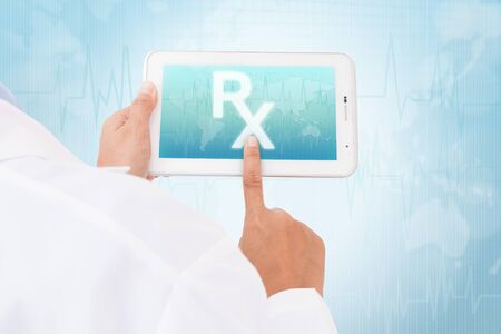 doctor tablet: Doctor hand touch screen Prescription symbol on a tablet. medical icon Stock Photo
