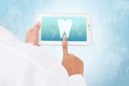doctor tablet: Doctor hand touch screen Tooth symbol on a tablet. medical icon