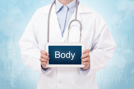 silhouette sign: Doctor holding a tablet pc with body sign on blue background Stock Photo