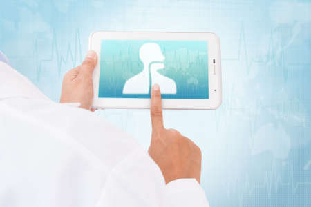 Doctor hand touch screen Esophagus symbol on a tablet. medical icon