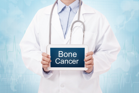 bone cancer: Doctor holding a tablet pc with Bone cancer sign on the display Stock Photo