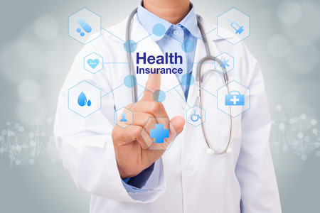 Doctor hand touching health insurance sign on virtual screen. medical concept Archivio Fotografico