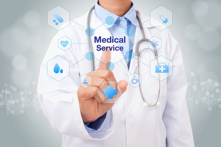 Doctor hand touching medical service sign on virtual screen. medical concept
