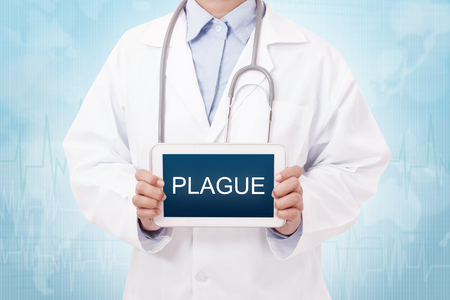 plague: Doctor holding a tablet pc with plague sign on blue background Stock Photo