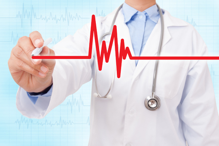 Doctor hand drawing cardiogram and electrocardiogram on blue background