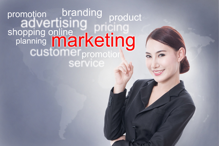selling points: Businesswoman pointing at marketing word on screen. business concept. Stock Photo