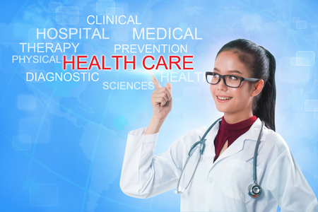 midwifery: Doctor hand touching HEALTH CARE word on screen with blue background. medical concept