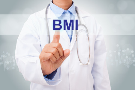 BMI: Doctor hand touching BMI sign on virtual screen. medical concept