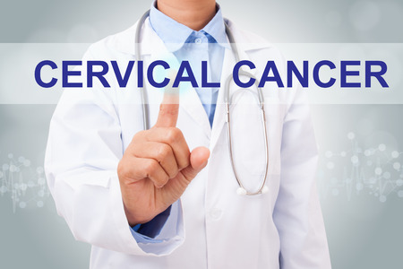 Doctor hand touching cervical cancer sign on virtual screen. medical concept Archivio Fotografico