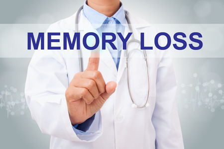 brain aging: Doctor hand touching memory loss sign on virtual screen. medical concept Stock Photo