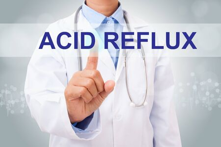 acid reflux: Doctor hand touching acid reflux sign on virtual screen. medical concept Stock Photo