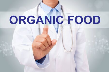 pointing herb: Doctor hand touching oragnic food sign on virtual screen. medical concept Stock Photo