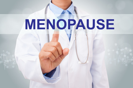 midlife: Doctor hand touching MENOPAUSE sign on virtual screen. healthy concept