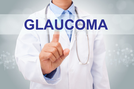 optic nerves: Doctor hand touching GLAUCOMA sign on virtual screen. healthy concept Stock Photo