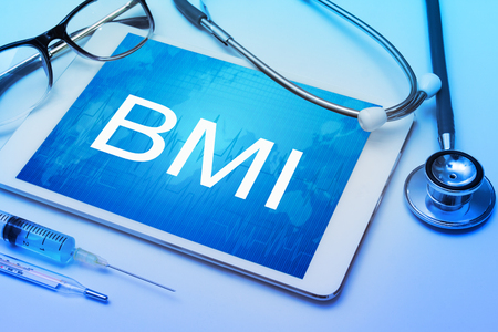 BMI, Body Mass Index sign on tablet screen with medical equipment on background Archivio Fotografico