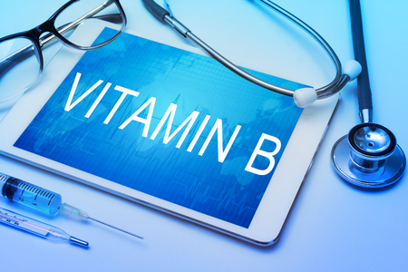 Vitamin B word on tablet screen with medical equipment on background Archivio Fotografico
