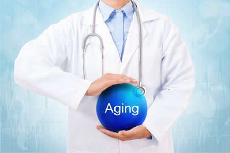 radicals: Doctor holding blue crystal ball with aging sign on medical background.