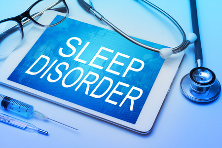 somnolence: Sleep Disorder word on tablet screen with medical equipment on background