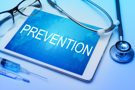 preventative: Prevention word on tablet screen with medical equipment on background