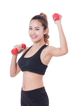 Portrait of young woman doing exercise with lifting weights Stock Photo