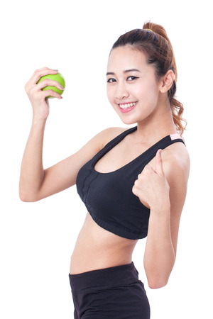 thump: healthy diet eating woman holding apple for weightloss and showing thump up on white background