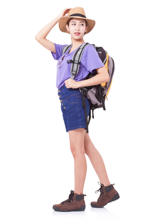 knapsacks: Woman traveler standing on the floor with backpack on white background