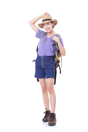 Young woman traveler with backpack on white background