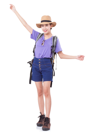 Full length of young woman in casual walking with the travel bag on white background