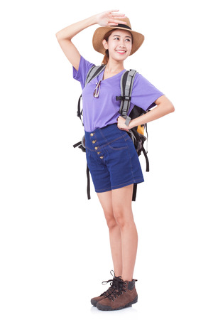 knapsacks: Full length of young woman in casual walking with the travel bag on white background