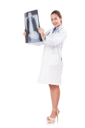 roentgen: female doctor holding x-ray or roentgen image. Stock Photo