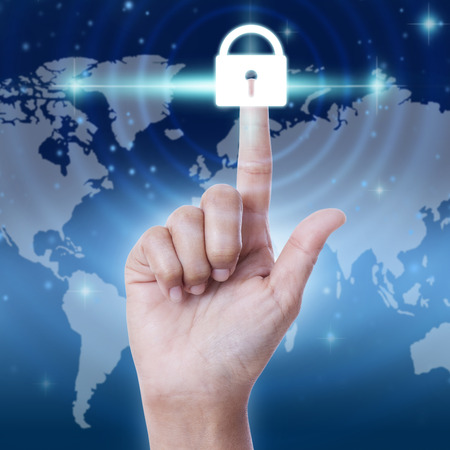 cyber defence: hand pressing security button on virtual screens. business concept