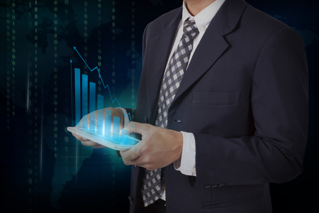 Businessman hand touch screen growth chart on a tablet, communication concept. Stock Photo