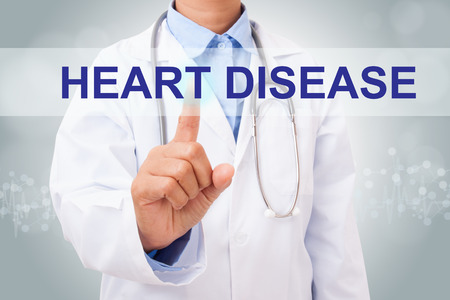 tachycardia: Doctor hand touching heart disease sign on virtual screen. medical concept