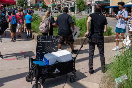 Volunteers offer free cold water and masks during Black Lives Matter Protest in Bloomington, Indiana, USA. June 5th 2020