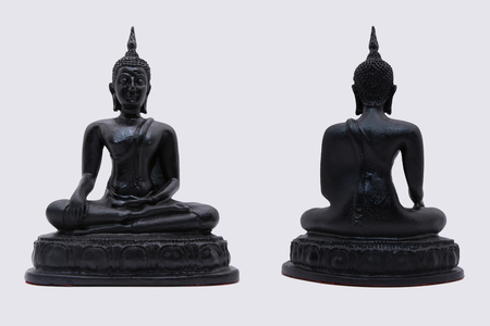 ancient philosophy: Black Buddha statue used as amulets of Buddhism religion Stock Photo
