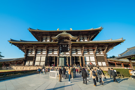 NARA, JAPAN - DECEMBER 3, 2017: Tourist go to Todaiji Temple Hall for worship Great Buddha on Holiday at Nara, Japan.